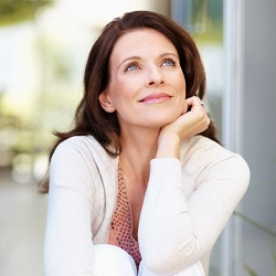 Lovely mature woman looking away in thought